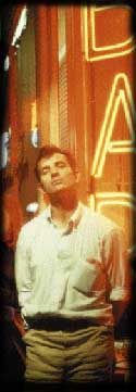 Jack Kerouac in front of neon Bar sign